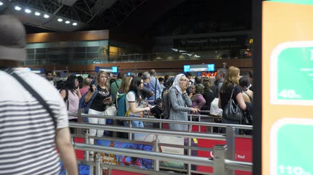 pasaport : Baku, Azerbaijan, 20-05-2019: Tired passengers are standing in long line and waiting passport control to flight in airport terminal. Check in in Baku, Heydar Aliyev airport. Stok Video