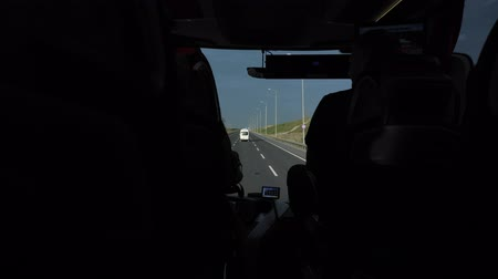 navigator : View of the highway from the front window of the bus. Bus ride among the mountains. Travel concept.