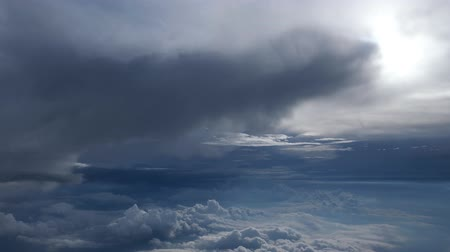 puffy cloud : Stunning footage of aerial view among clouds from airplane window with blue sky. View from the airplane window to the blue sky and white clouds.