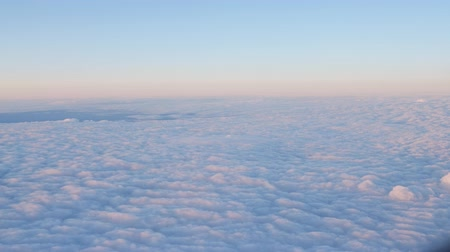 ozón : Beautiful blue clouds surface in sunset sky, view from plane during flight Dostupné videozáznamy