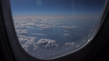 soft earth : Cloudscape of aerial view above clouds from airplane window.
