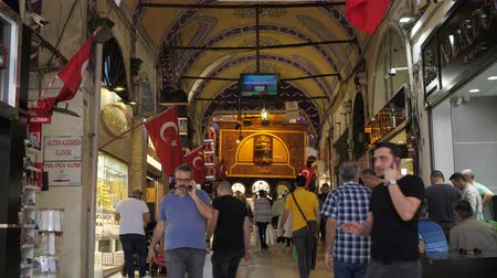 ISTANBULTURKEY - JULY 30 2019: Tourists walk along passage between different souvenir shops and stores in traditional Istanbul shopping mall on July 30 in Istanbul Stock Footage
