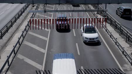 ISTANBULTURKEY - JULY 30 2019: Different automobiles drive along multi-lane freeway with dividing barriers in Istanbul on sunny day close upper view on July 30 in Istanbul