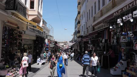 ISTANBULTURKEY - JULY 30 2019: Crowd of tourists and locals walks past different shops on Istanbul pedestrian street under clear blue sky on sunny day on July 30 in Istanbul