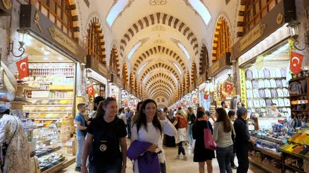 ISTANBULTURKEY - JULY 30 2019: Crowd of happy tourists walks between different shops and stores in traditional Turkish covered market in Istanbul on July 30 in Istanbul Stock Footage