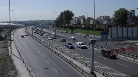 ISTANBULTURKEY - JULY 30 2019: Automobiles drive on modern highway running along calm azure sea against clear blue sky on sunny day