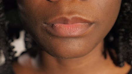 ぽってり : pretty Afro-American lady with curly hair plump lips perform air kiss and smile slow motion extreme close view