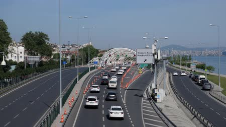 ISTANBULTURKEY - JULY 30 2019: Automobiles drive on modern highway running along calm azure sea against clear blue sky on sunny day in Istanbul on July 30 in Istanbul Stock Footage