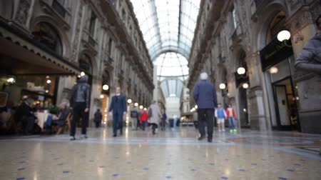 galleria vittorio emanuele ii : MILAN, ITALY - MAY 7, 2014 : Buyer in trade Galleria Vittorio Emanuele II in Milan. Its one of the worlds oldest shopping malls, designed and built by Giuseppe Mengoni between 1865 and 1877