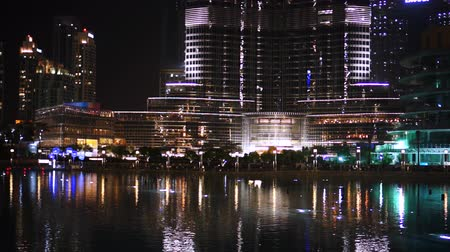 largest city : DUBAI, UAE - JANUARY 2018: Fountain near Burj Khalifa illuminated by the city