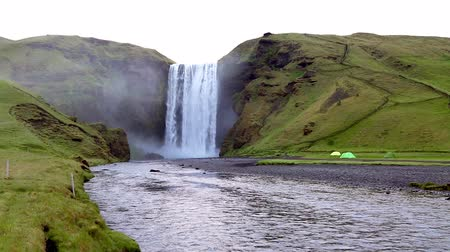 Famous Skogafoss waterfall. Popular tourist attraction. Location Skoga river, Iceland, Europe. Unique place on earth. Explore the worlds beauty. Save environment. Shooting in HD 1080 video. Stock Footage