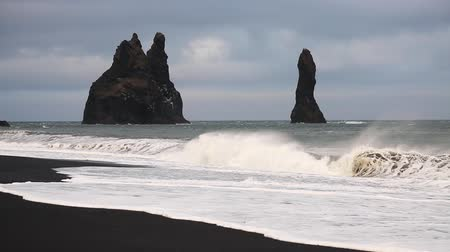 Reynisdrangar (Troll toes), basalt sea stacks situated near the village Vik i Myrdal. Unusual and gorgeous scene. Location place Sudurland, Iceland, Europe. Beauty world. Shooting in HD 1080 video.