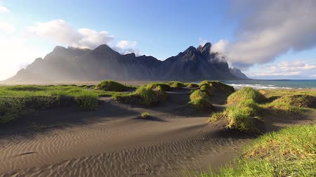 Unique green hills glowing by sunlight. Picturesque and gorgeous scene. Popular tourist attraction. Location Stokksnes cape, Vestrahorn (Mt. Batman), Iceland, Europe. Time lapse clip. Beauty world. Stock Footage