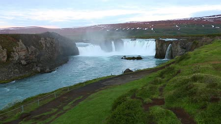 Nice views of the bright sunlit powerful Godafoss cascade. Popular tourist attraction. Unusual and picturesque scene. Location Bardardalur valley, Skjalfandafljot river, Iceland, Europe. Beauty world.