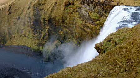 skogafoss : top view pan camera Skogafoss powerfull waterfall in iceland Popular tourist attraction shoot in 1080 Stock Footage