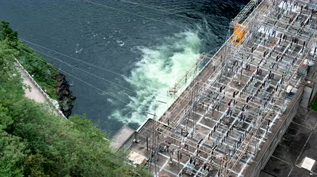 upstream : Electricity generating dam working on Stock Footage