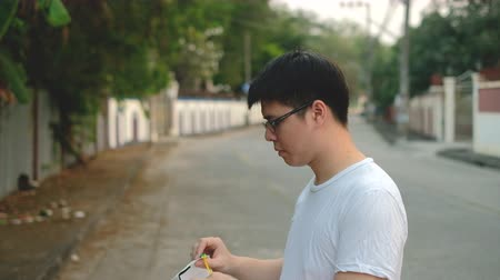щит : Asia young man wear N95 mask for protect bad pollution PM2.5 dust with brick background