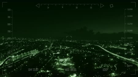 moscas : Drone flying over city at night