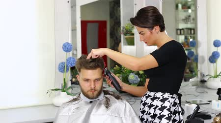 fryzura : The young man at the hairdresser salon hairstyle make model