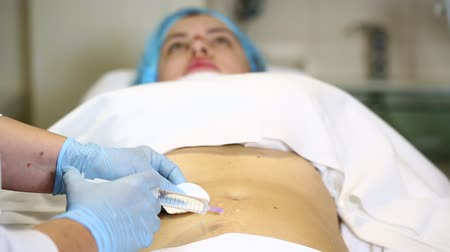 mezoterapia : woman is in the process cellulite mesotherapy clinic