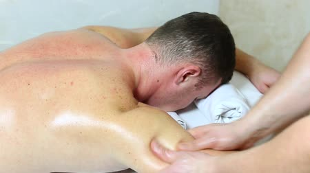 física : man doing sports massage at the massage parlor