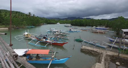 chata : El NIDO, PHILIPPINES - JANUARY. 1: The port and the boats in the fishing village of El Nido JANUARY. 1, 2016 in El Nido Philippines.