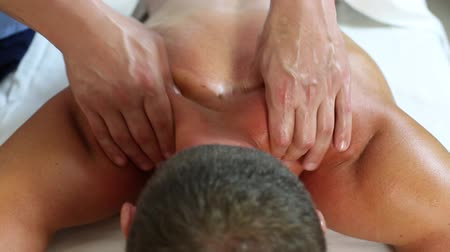 physical pressure : young man on wellness treatments sports massage Stock Footage