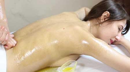 masaj : Girl treatment massage honey body wrap in a beauty salon