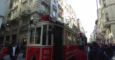 tramwaj : ISTANBUL, TURKEY - APRIL 3, 2016: Istiklal Street pedestrian street of the city with an old tram and street musicians shops and restaurants: APRIL 3, 2016 in Istanbul, Turkey