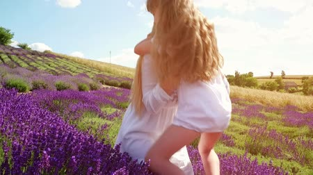 mother love : Family in lavender field, mother and daughter together having fun