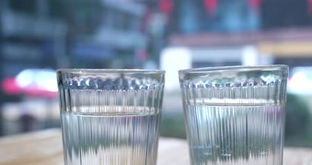 clear the table : Two glass of water glass with city background