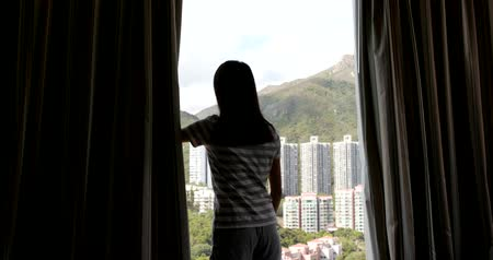 oportunidade : Woman open the window curtain