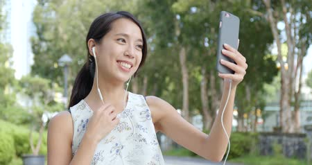 video making : Woman making a video call on cellphone Stock Footage