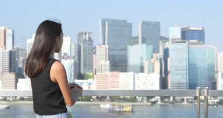 victoria : Woman looking at the harbour front in Hong Kong Stock Footage