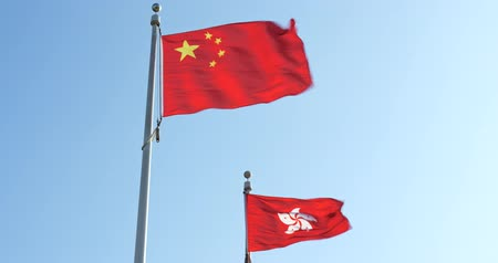 polinésia : Hong Kong and Peoples Republic of China Flags flying Stock Footage