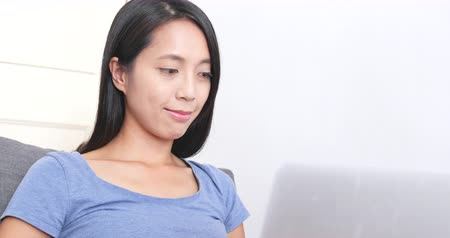 use laptop : Woman working on laptop computer at home Stock Footage
