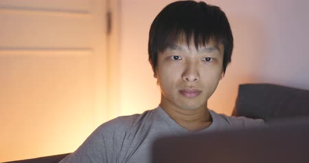 gentleman : Asian man using computer at home