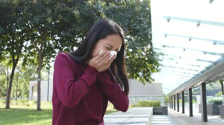 проданный : Woman sneezing at outdoor Стоковые видеозаписи