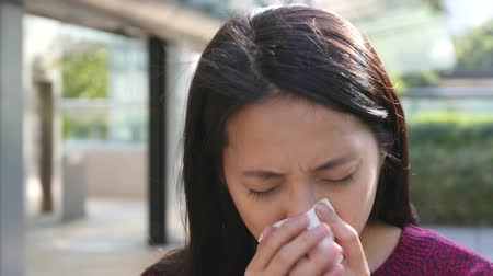 alerji : Woman sneezing at outdoor at autumn season Stok Video