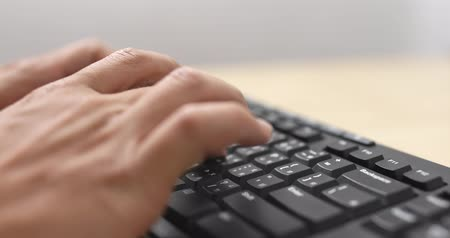 focus on foreground : Typing on computer keyboard
