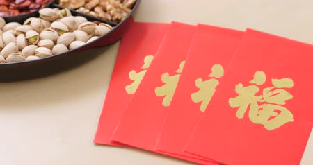 pan shot : Chinese new year assorted snack tray with red pocket Stock Footage