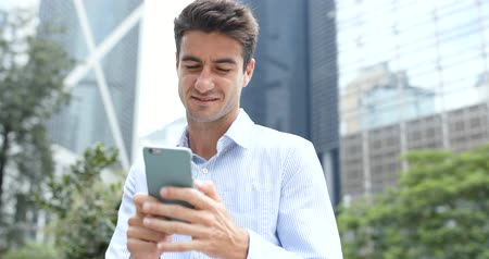spaniard : Caucasian man use of smart phone