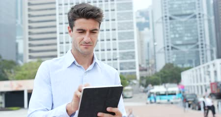 spaniard : Hispanic man use of digital tablet computer Stock Footage