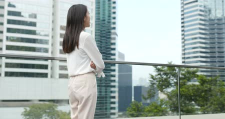 looking far away : Back rear view of business woman looking far away Stock Footage