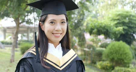 mezun : Happy woman university graduation day Stok Video