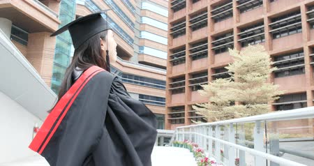 commencement : Young asian woman look at top in university campus