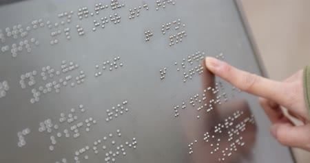 слепой : Blind reading on braille at outdoor