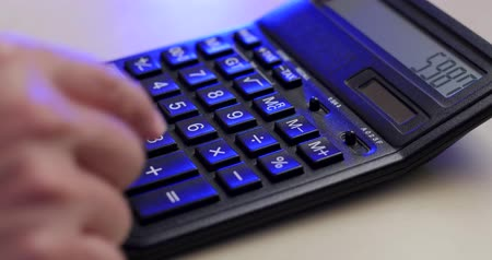 contas : Using calculate with blue light Stock Footage