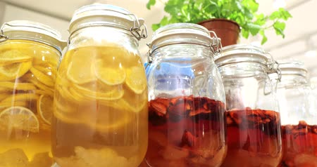 kompot : Canned compotes fruit syrup in preservation glass jars Wideo