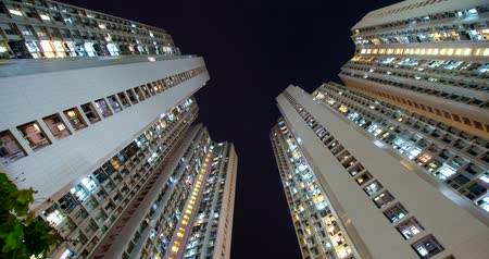 шуй : Tin Shui Wai, Hong Kong, 18 April 2018:- Timelapse of Hong Kong residential skyscraper at night